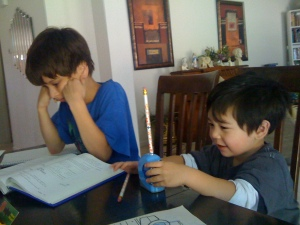 3 year old son, Pio, sharpens a pencil for the first time.